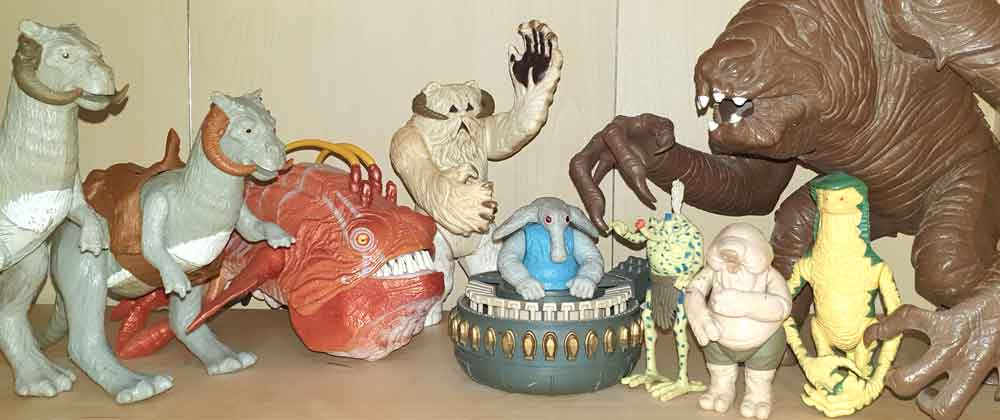Star Wars creatures. From left to right: tauntauns, opee, wampa, Max Rebo (in ball organ), Sy Snootles, Droopy McCool, Amanaman, rancor. We'll be talking about some of these creatures below. Image: Darren Naish.