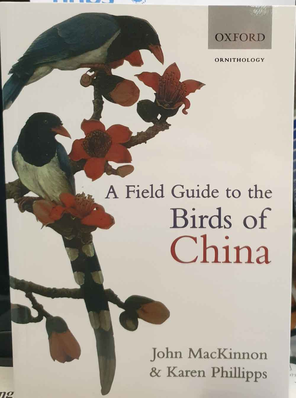 MacKinnon & Phillipps (2000),  A Field Guide to the Birds of China .   It's not the most attractive field guide out there, but it does seem to be the best one. Image: Darren Naish.
