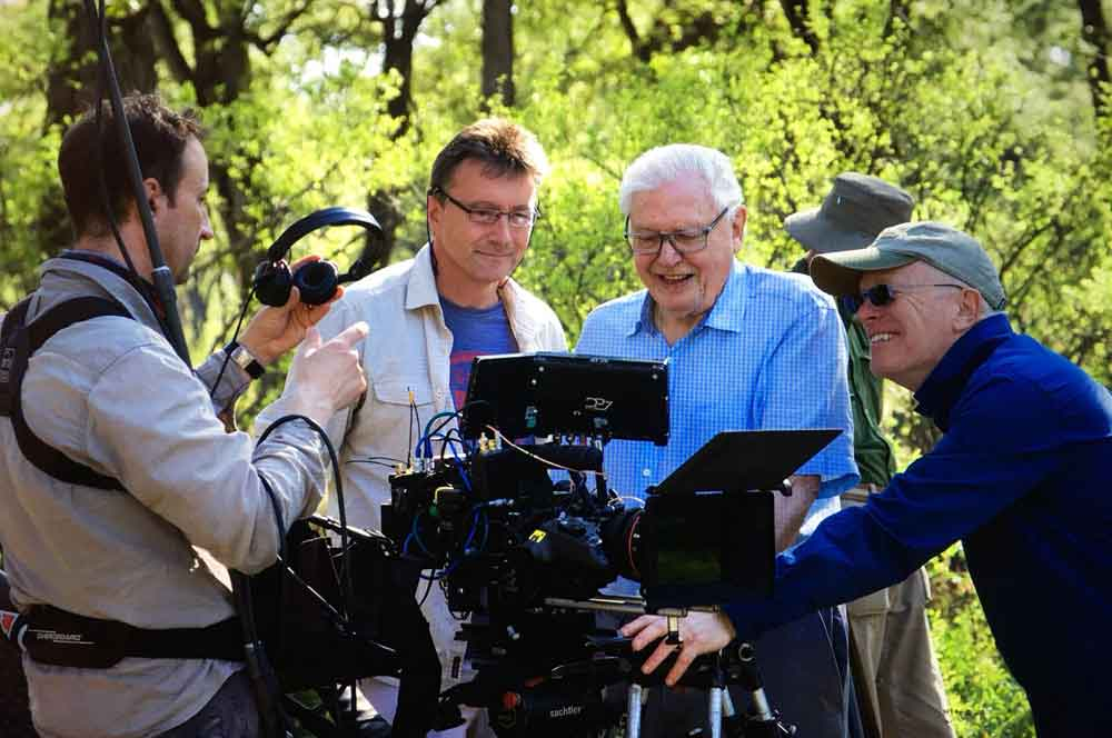 Wildlife film-maker, producer, author and qualified zoologist Dr Paul Stewart (in the middle; here with Sir David Attenborough and other team members) will be at TetZooCon 2019. Image: (c) Paul Stewart, used with permission.