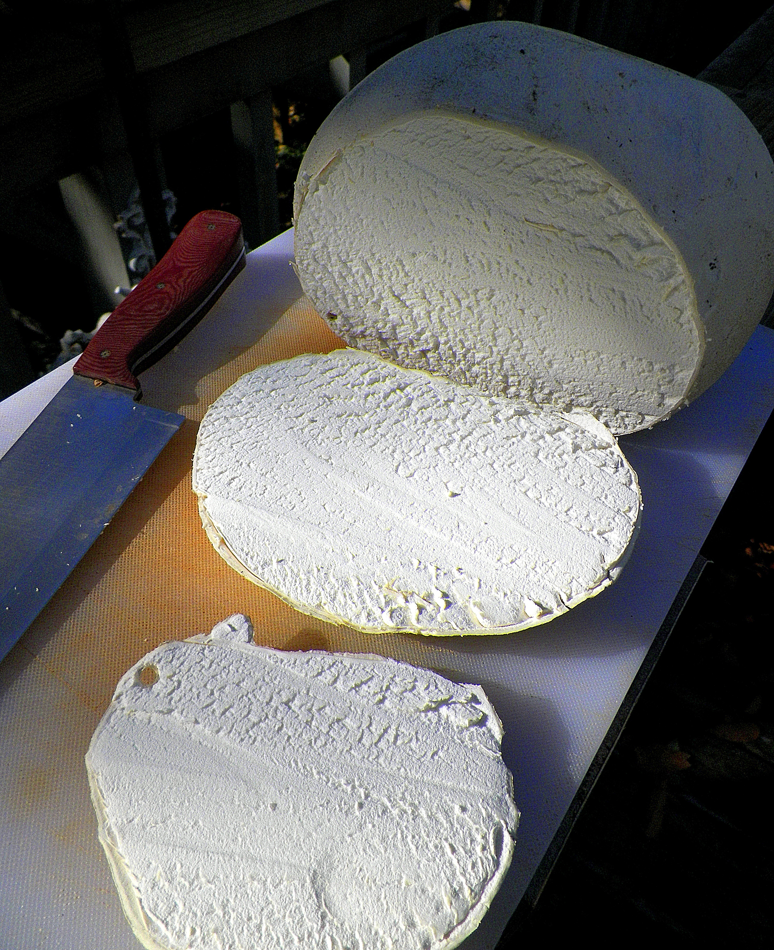 Slicing a giant puffball. Note the clean white flesh and leather-like outer skin. i sliced this one with a chef's knife, which makes a little rougher cut, so that you can get a better sense of the texture of the meat of the mushroom. Compare to the image below of the puffball I sliced with a fillet knife.