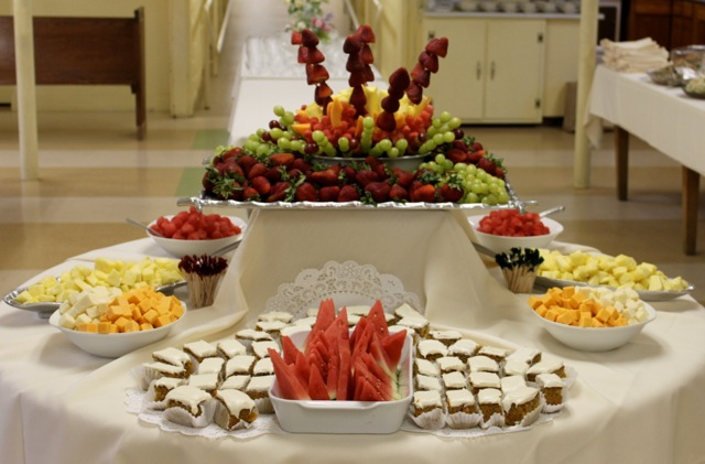 A fruit and carrot cake spread for a catered event.