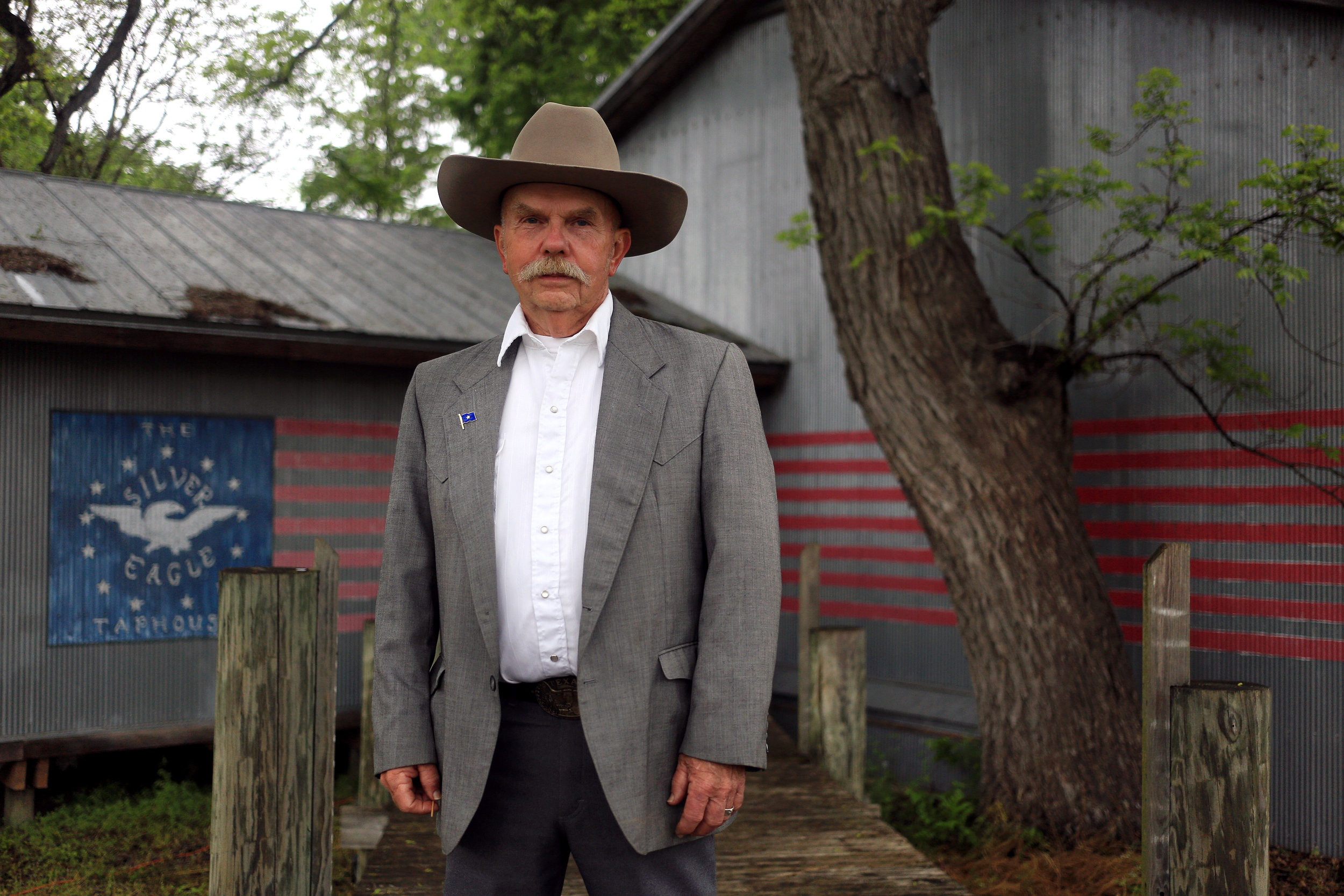 """John Jarneke, president of the Republic of Texas, lamented taking his tie off before he was photographed outside the Silver Eagle Taphouse in McQueeny, TX. The 72-year-old retired construction contractor from Fredericksburg has a vision of Texas where """"people will be friendlier and less worried"""" with a smaller government, less police and lower taxes."""