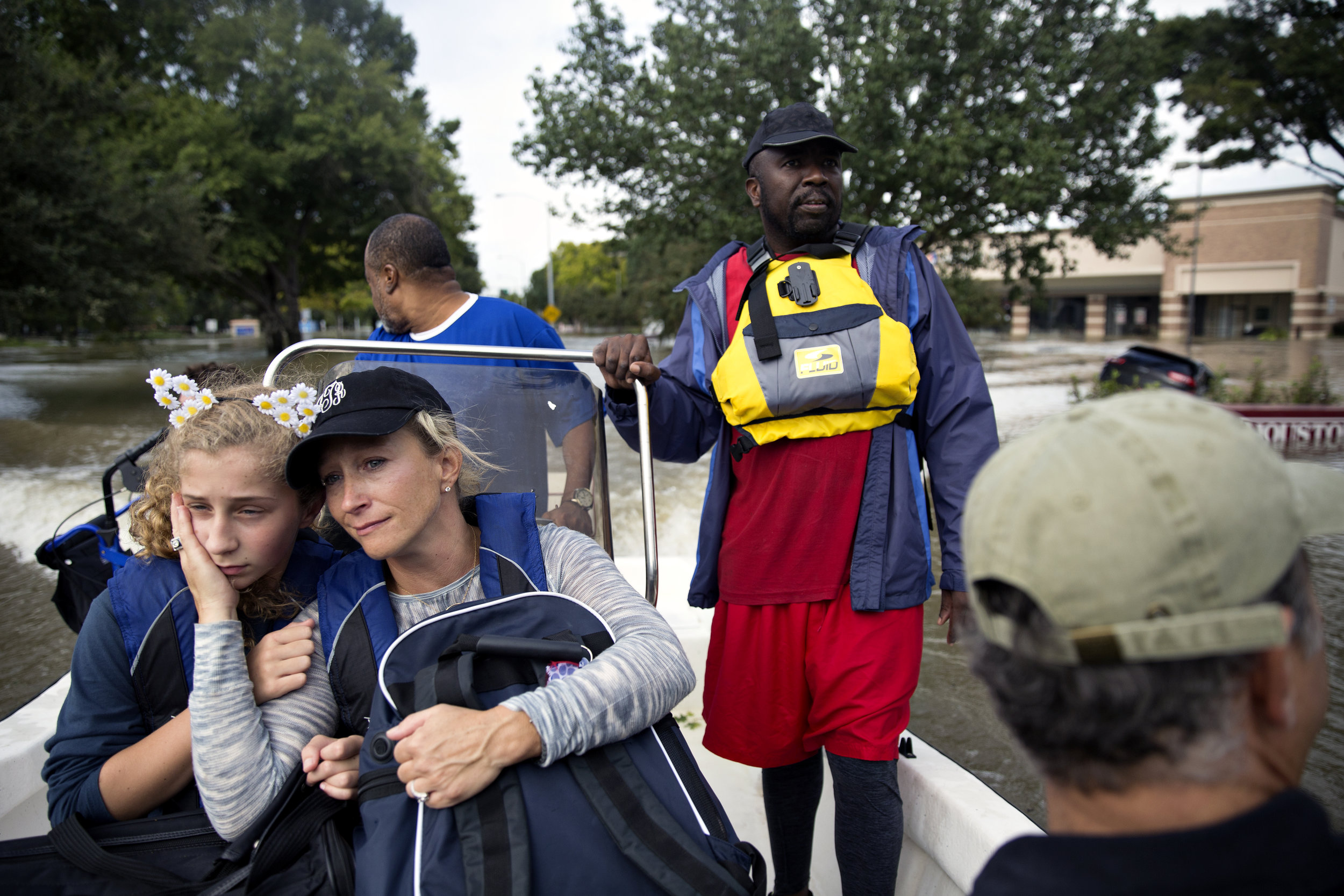 Jill Terrell holds her daughter Lucy, 12, after being rescued by the Cajun Navy from their flooded neighborhood in Houston's Energy Corridor on Aug. 29, 2017.