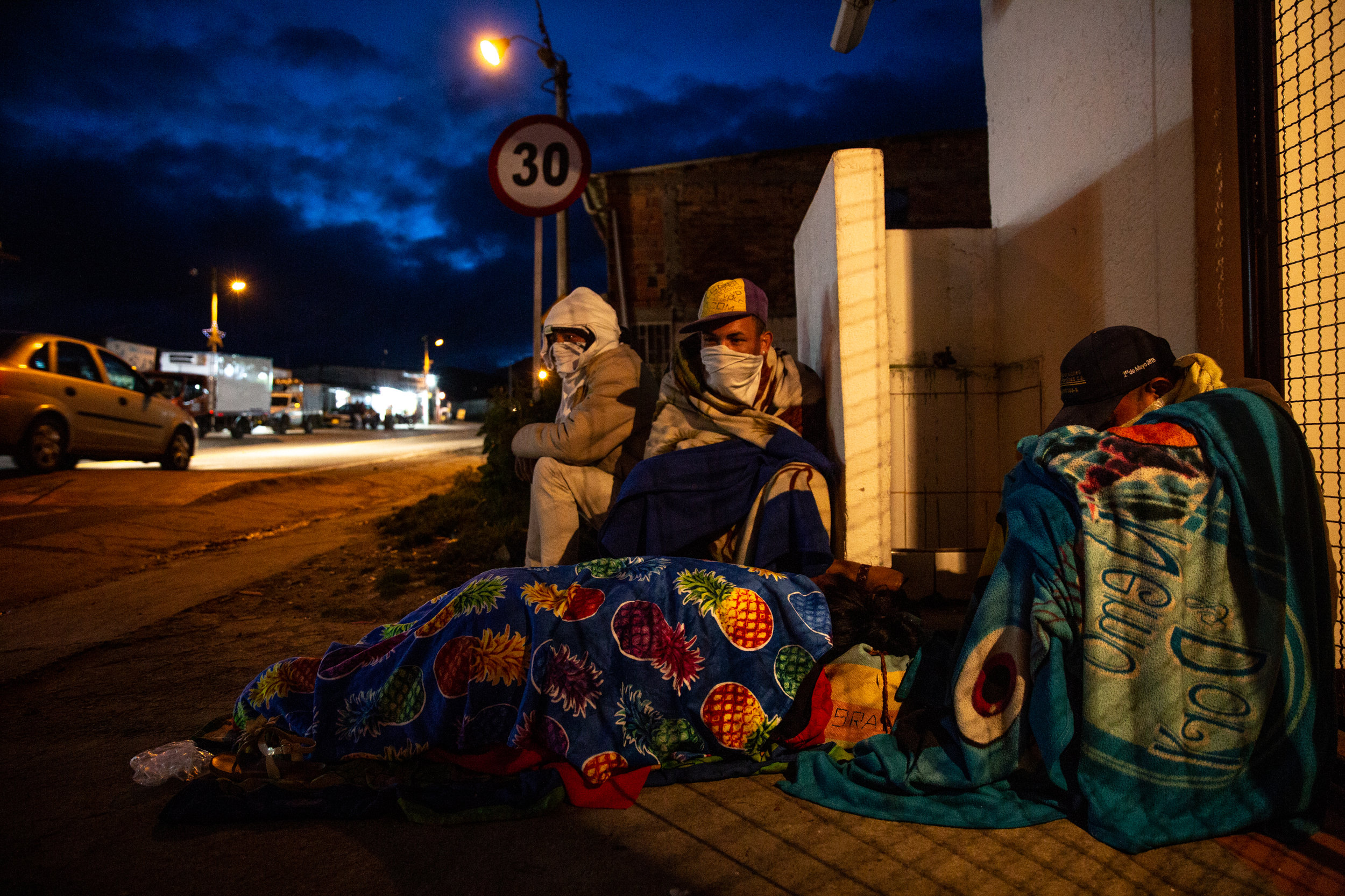 After a two-day trek from the Venezuelan border, migrants prepare to sleep outside in the cold highlands. La Laguna, Colombia.