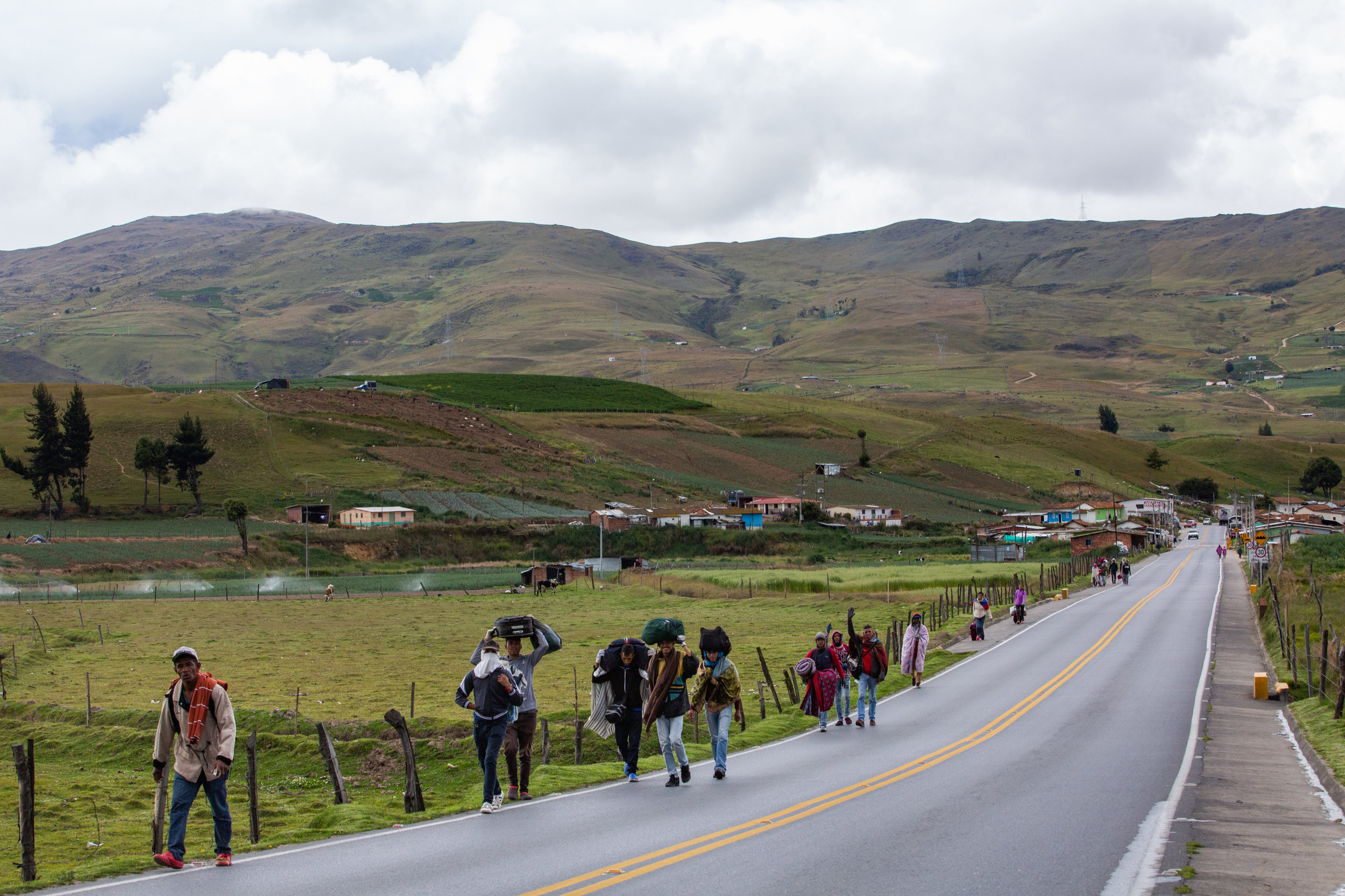 Venezuelan migrants travel on foot along a highway through the paramo de Berlin in the Andean highlands of Colombia.