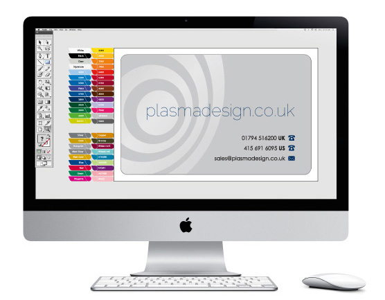 An iMac, shown face on, displaying a business card design in progress