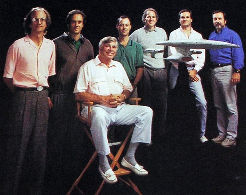 The creative team of Star Trek: The Next Generation - from left to right; David Livingston, Rick Berman, Gene Roddenberry, Michael Piller, Peter Lauritson, Rob Legato, Dan Curry. Not seen is Ron Moore, who took this photo.     This photo and the above caption are from TrekCore.com - A fantastic Star Trek resource.