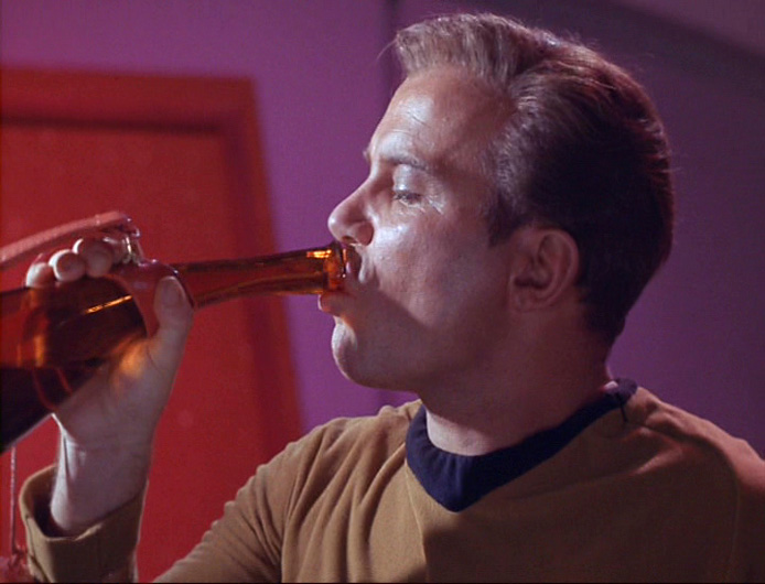 Kirk drinking some Saurian Brandy