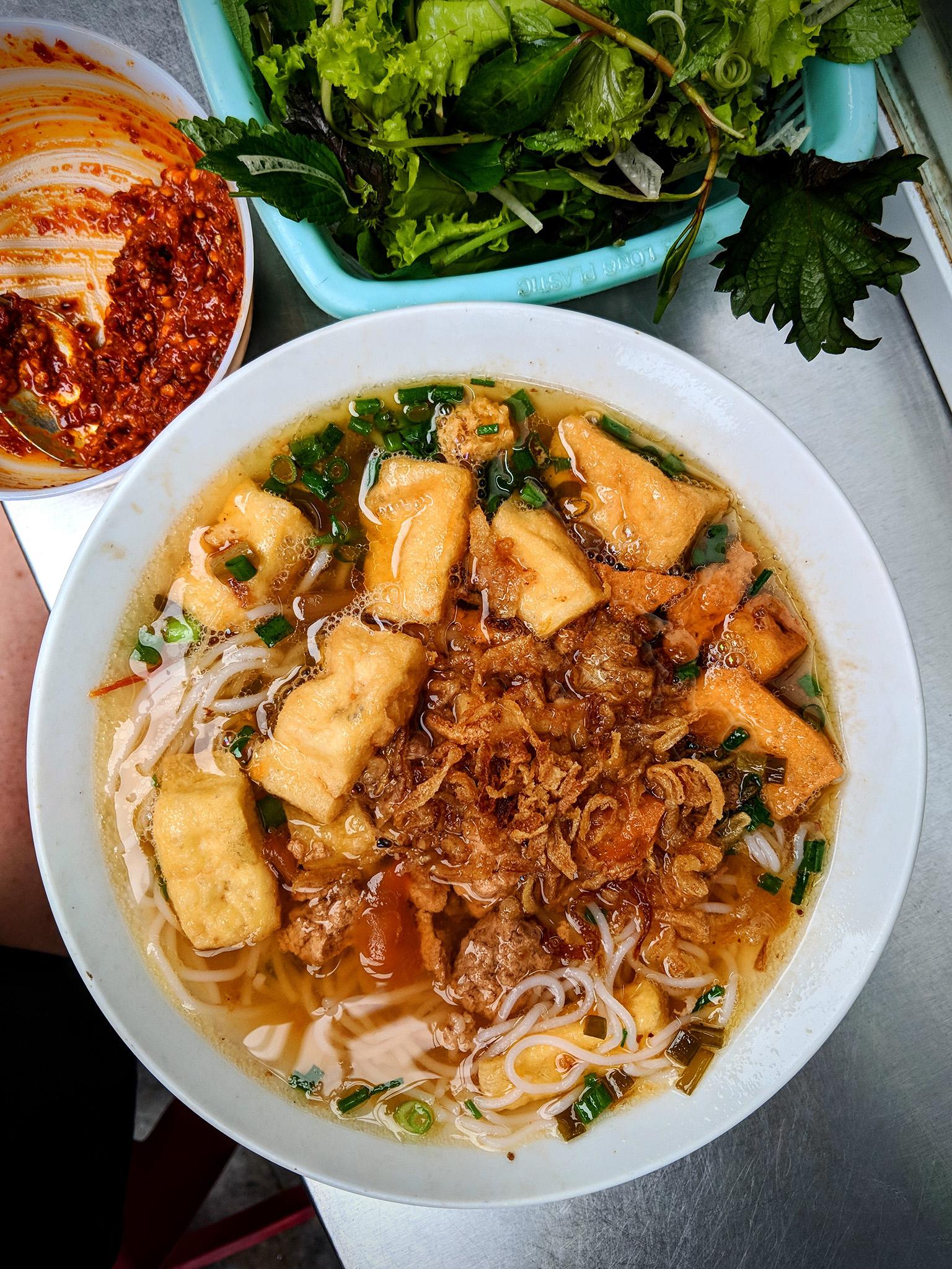 Delicious Bún riêu, a noodle dish with tomato-crab paste broth, at Bún Riêu Hàng Bạc