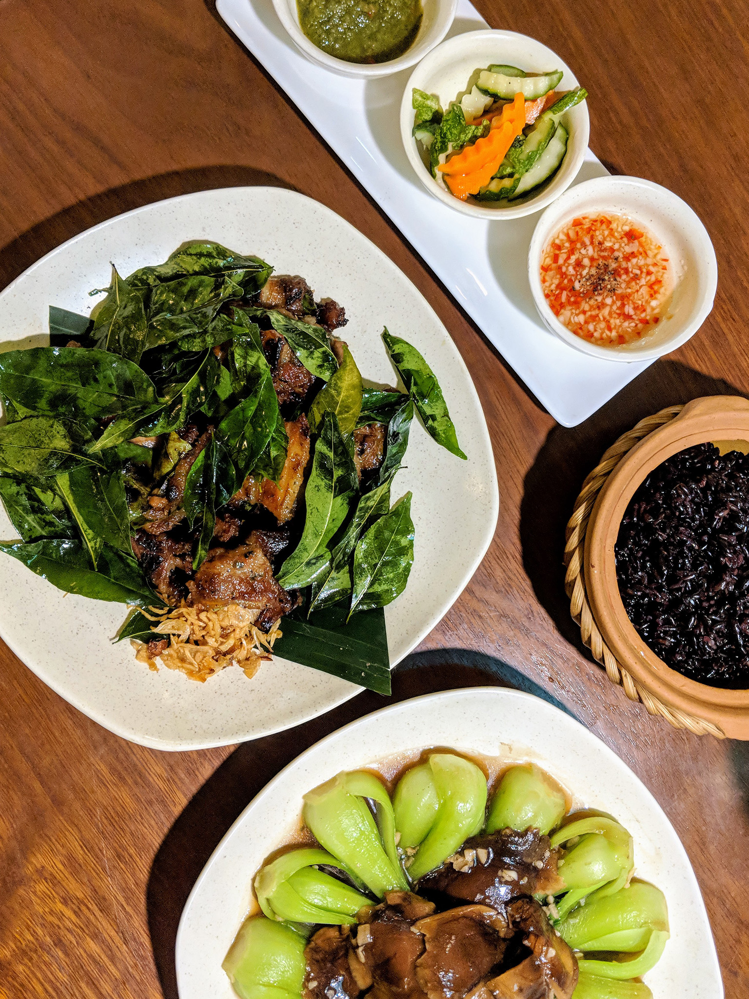 Splurge-worthy meal at Luk Lak. The lợn nướng was an extremely flavorful dish of tender pork belly grilled in kaffir lime leaves. Added black rice, bok choy and mushrooms to round it out.