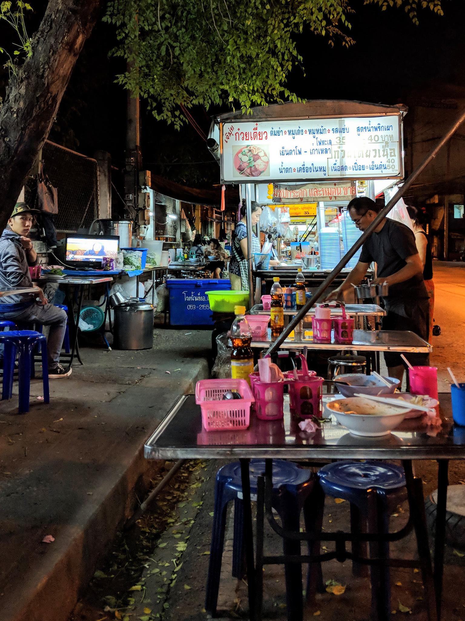 Dinner at a street vendor serving up pork noodles