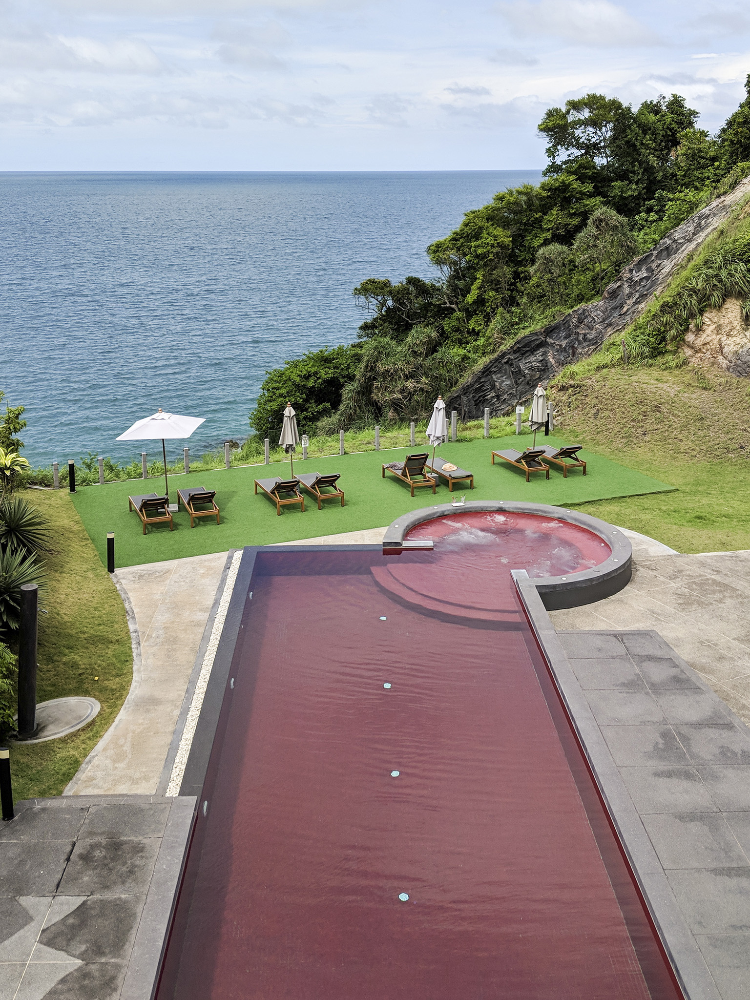 the striking red pool at the Houben Hotel