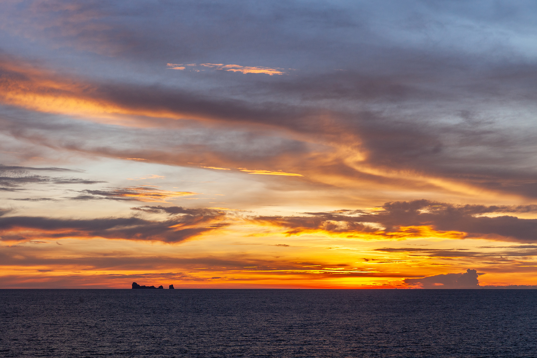 Sunset with the Phi Phi Islands on the horizon