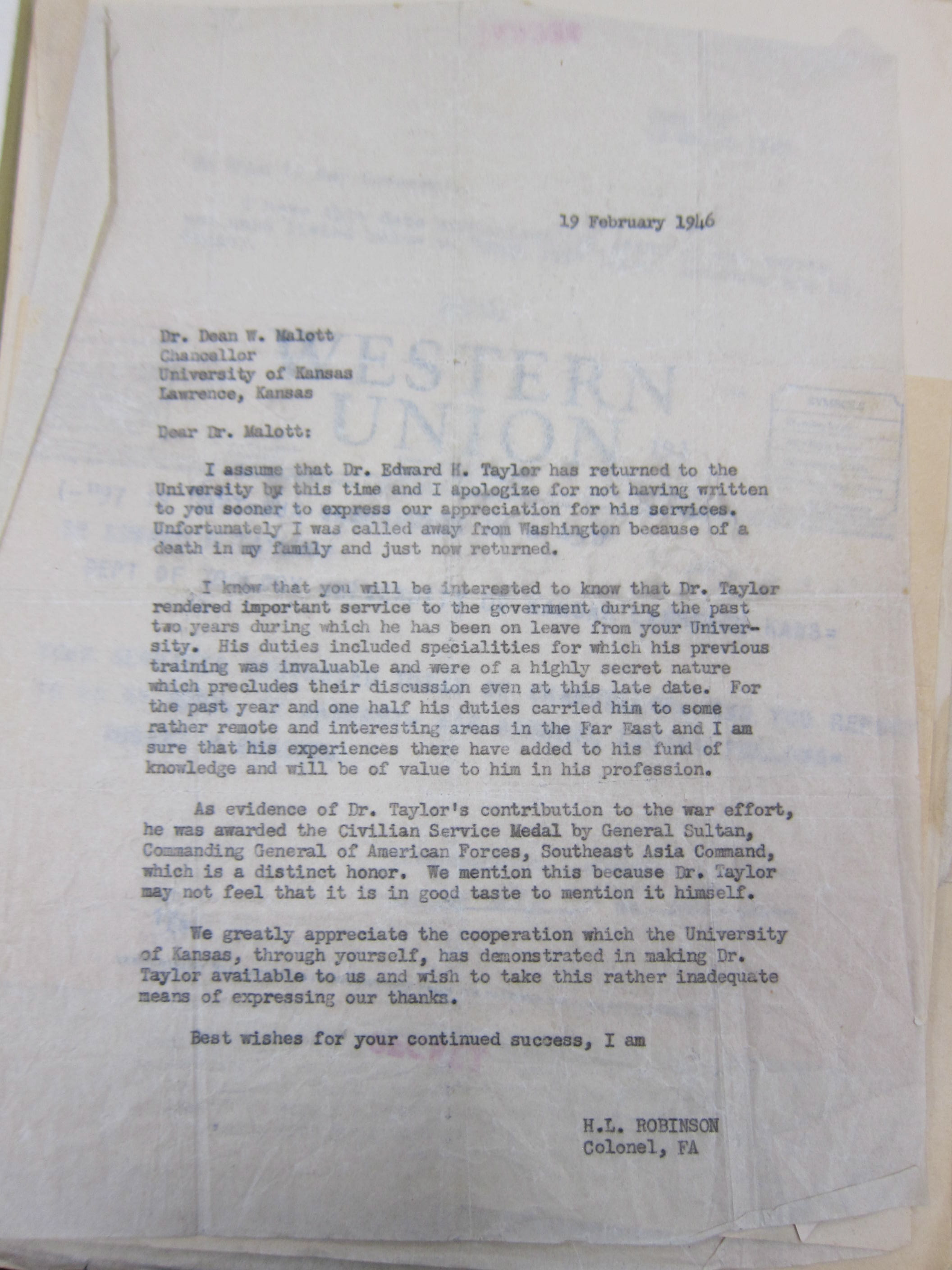 Letter from an OSS leader to Edward Taylor's dean at the University of Kansas