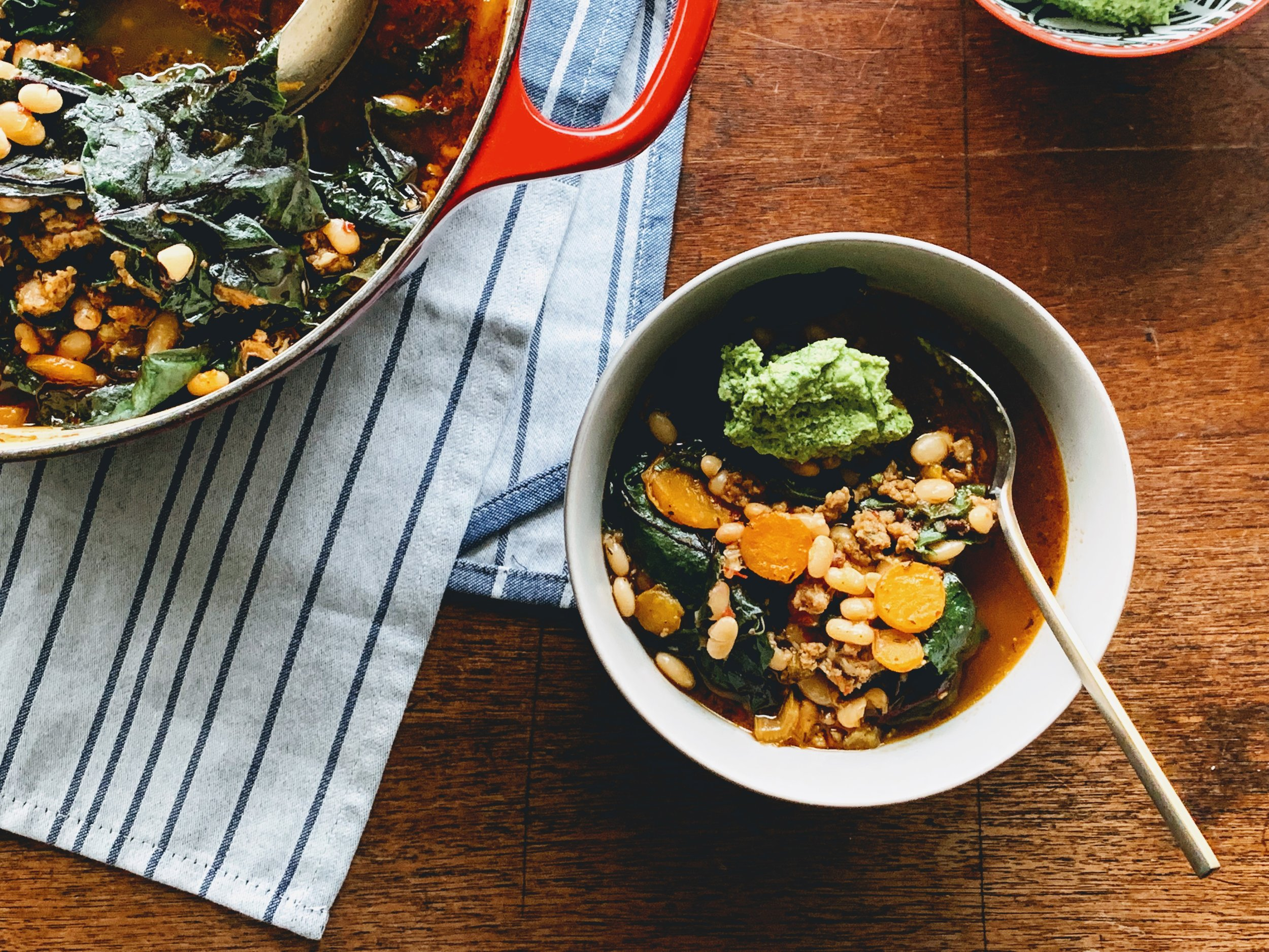 Swiss Chard, Sausage, and Bean Stew with Carrot Top Pesto