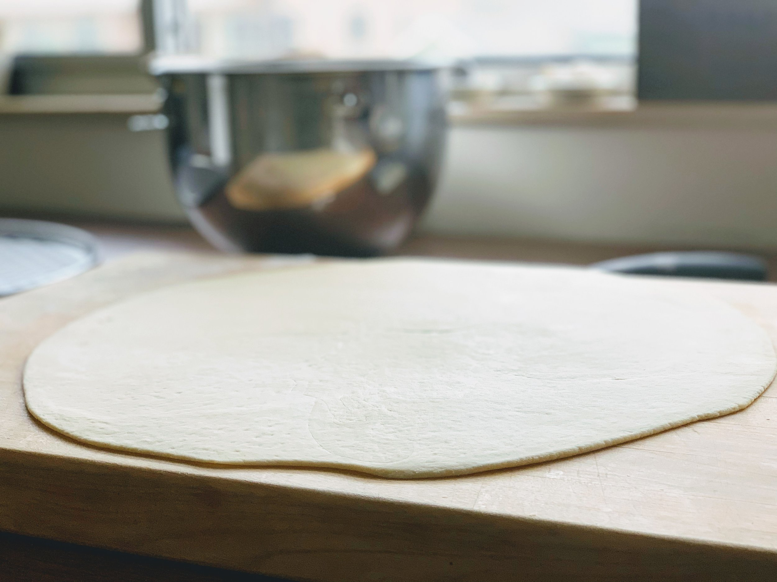 Chicago Thin Crust Pizza Dough Rolled .jpg