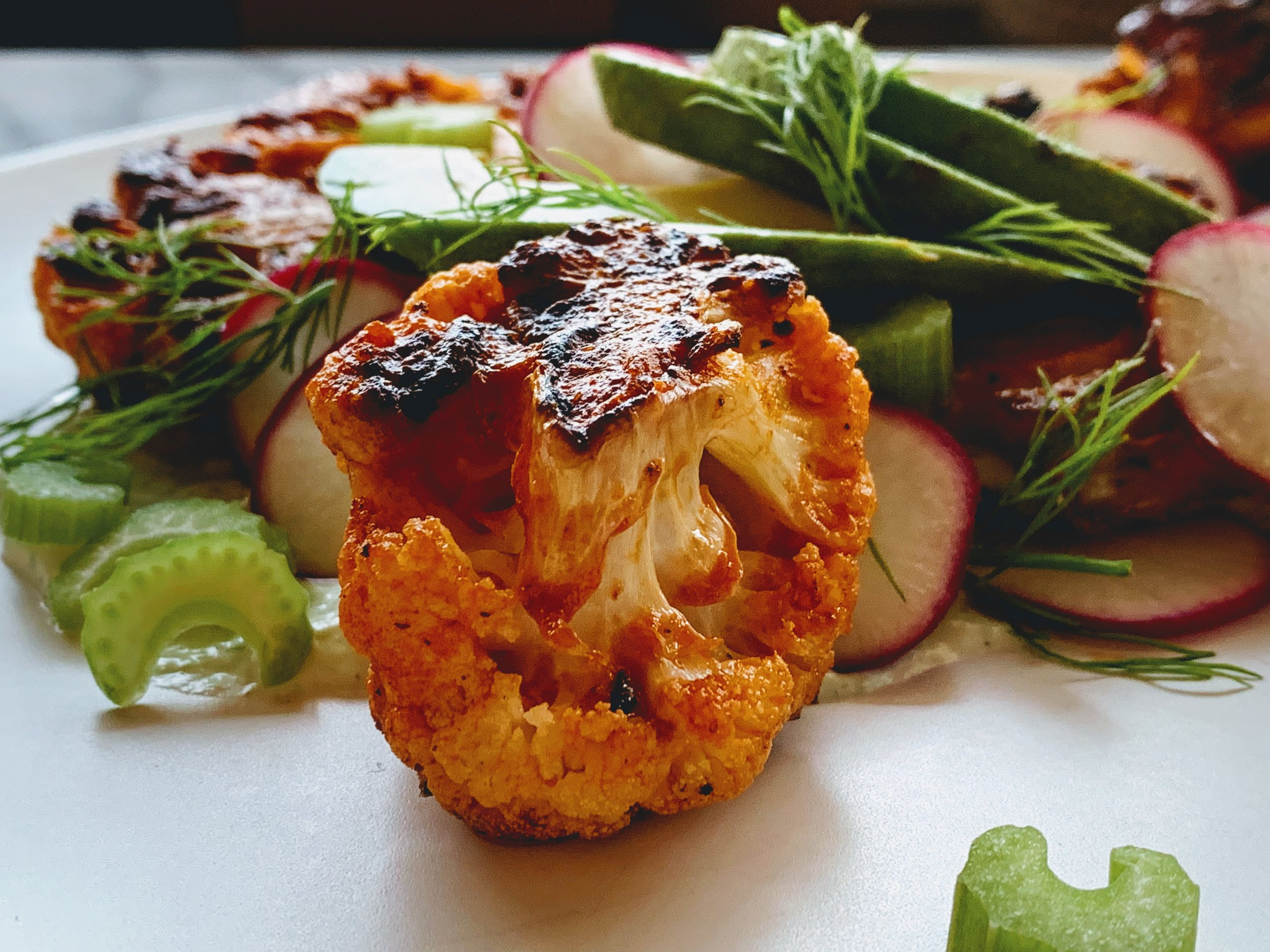 Buffalo Cauliflower Steaks with Whipped Goat Cheese Up Close.jpg