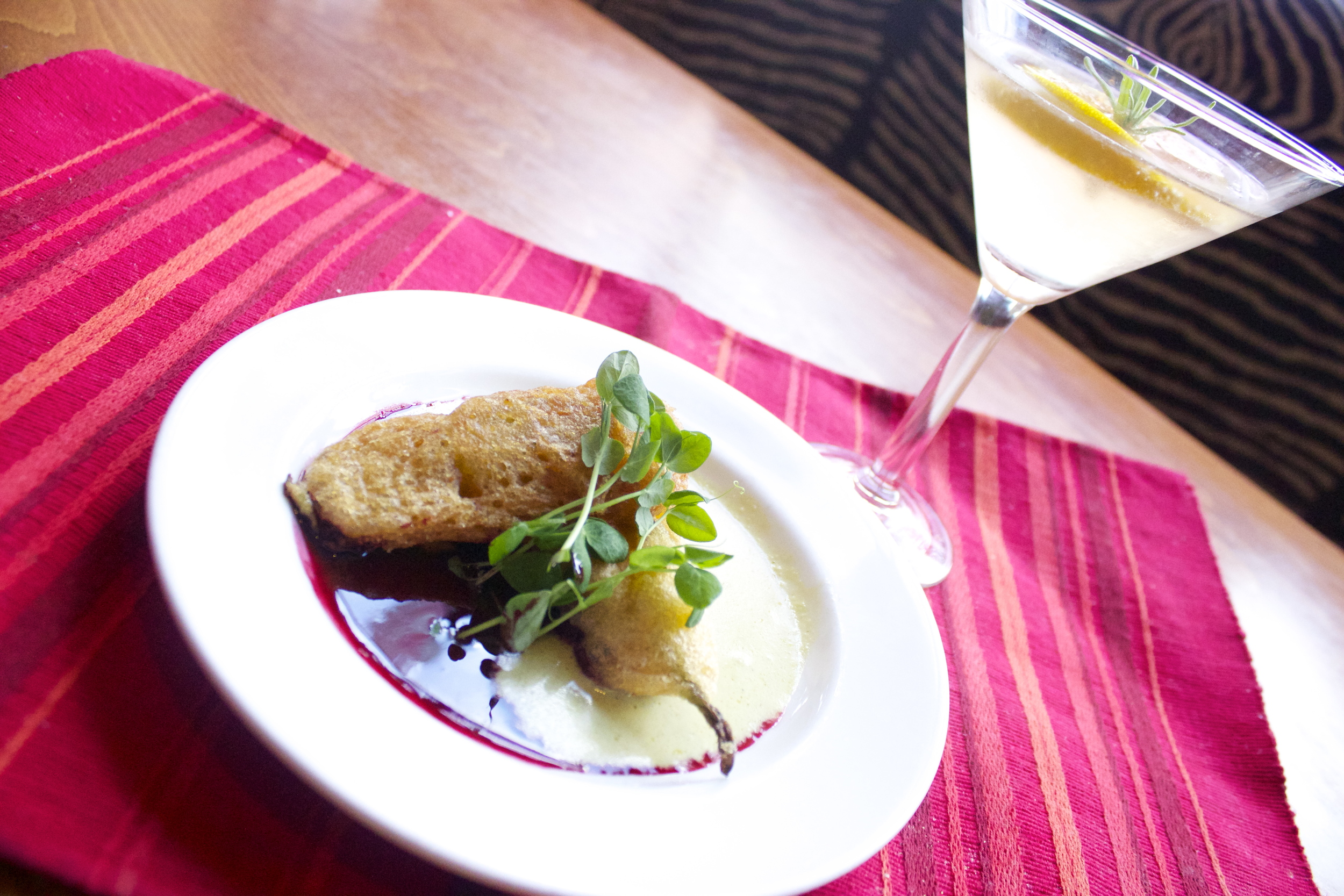 Casa Oaxaca :  Tempura battered Ricotta stuffed squash blossoms served with a spicy hibiscus salsa.