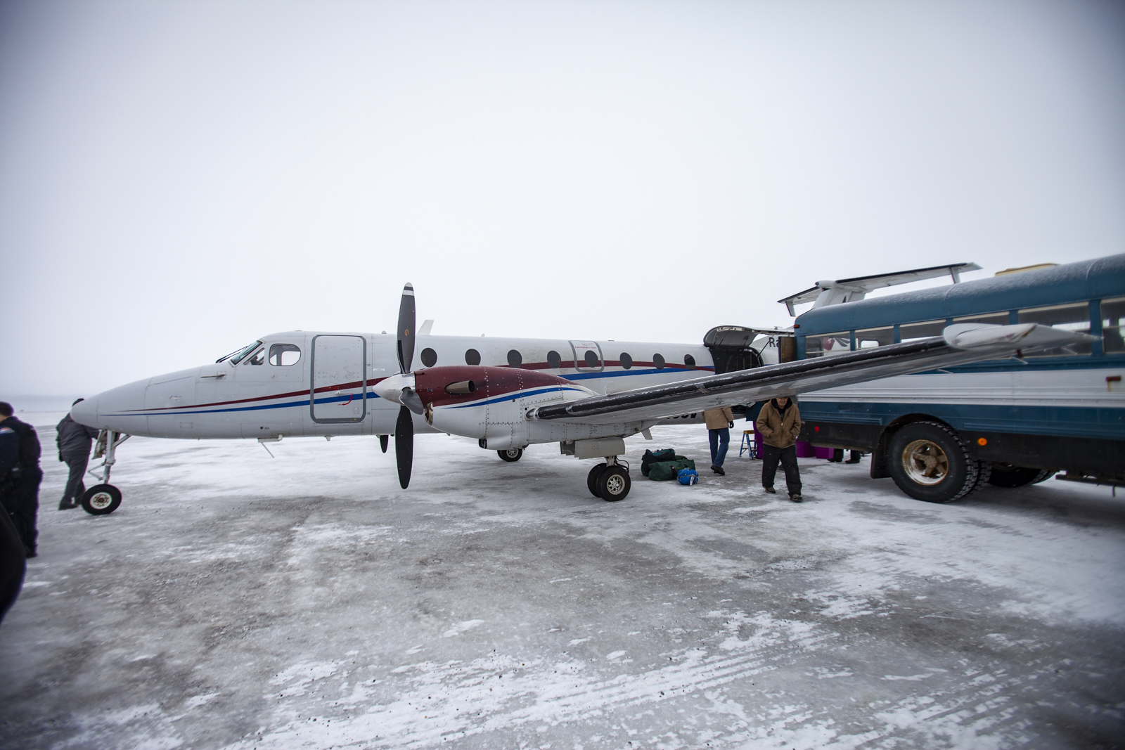 A small bus meets planes at the airstrip in Kaktovik