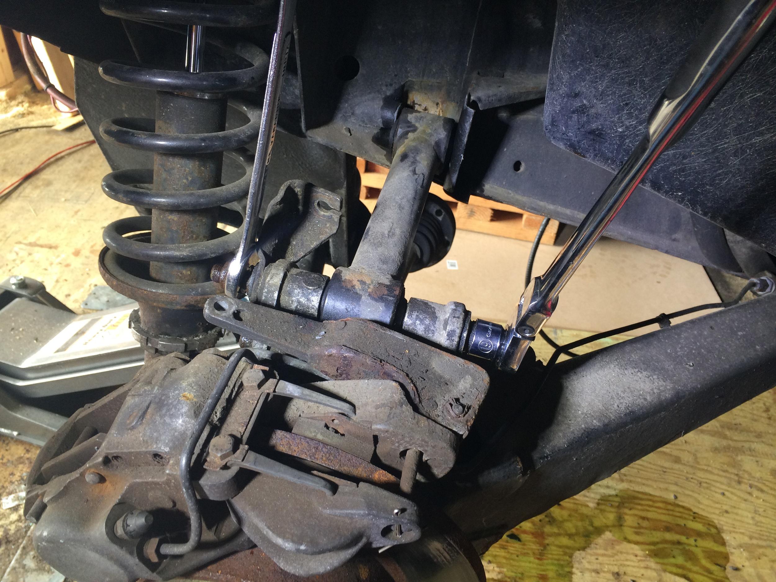 Removing the Upper Link Arm Bolt (Hub Carrier)