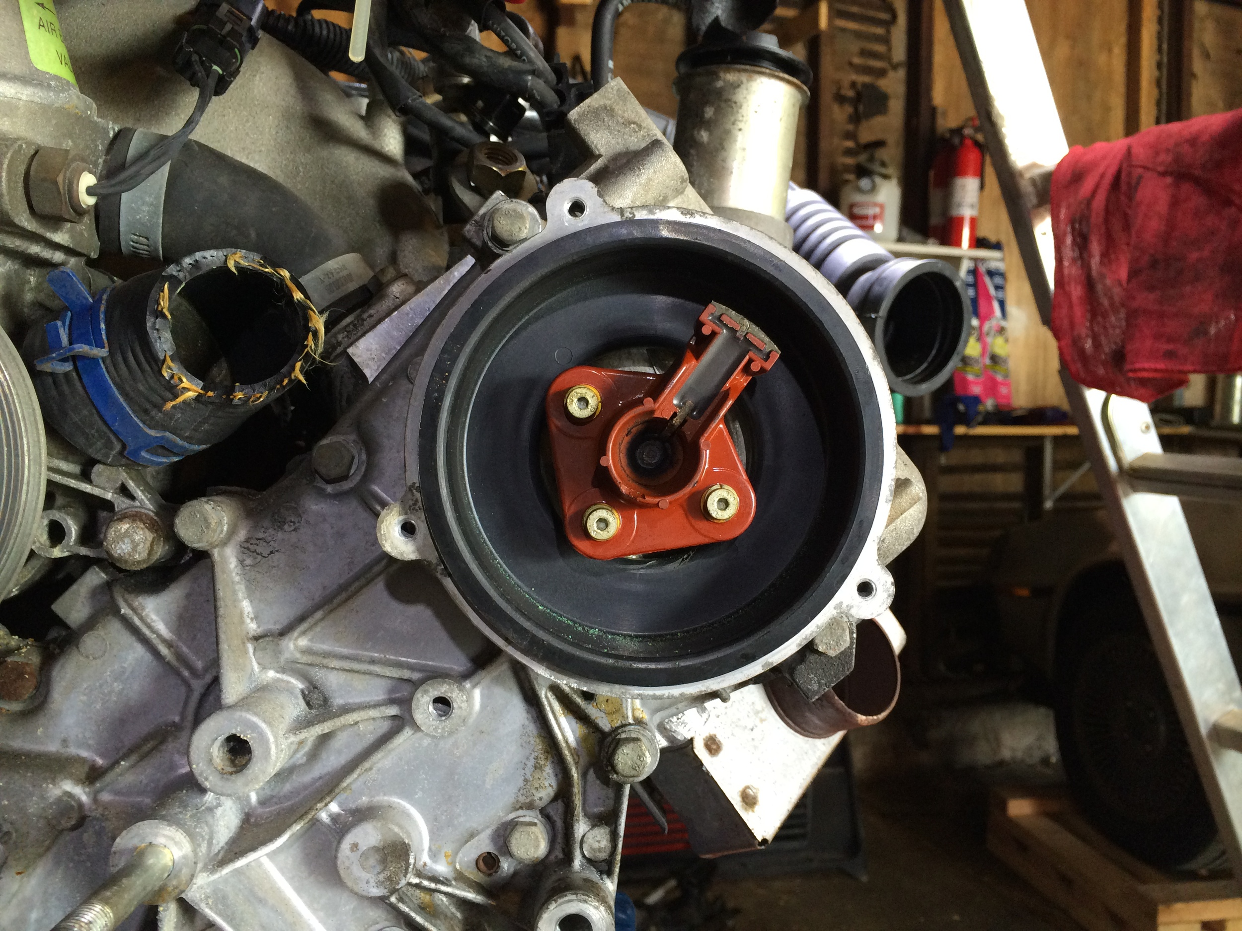 The distributor cap removed, revealing the rotor.
