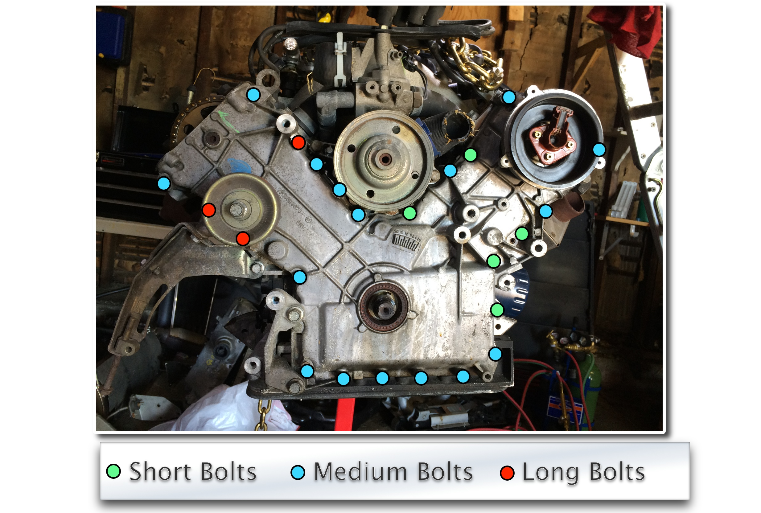 The timing cover is held on with 25 bolts (13mm socket) with a mix of bolt lengths.