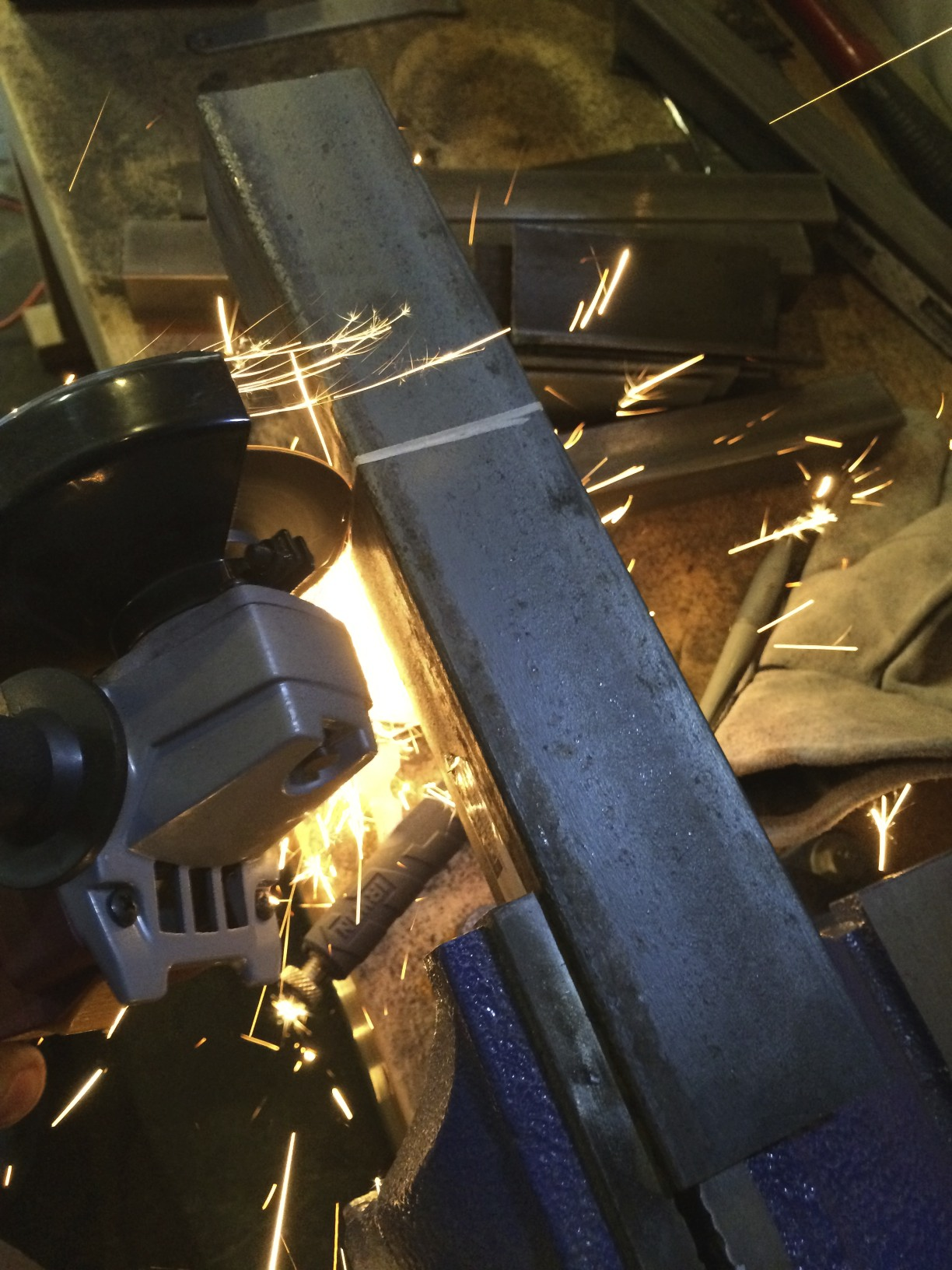 Cutting the square stock with an angle grinder and a cutting disc.