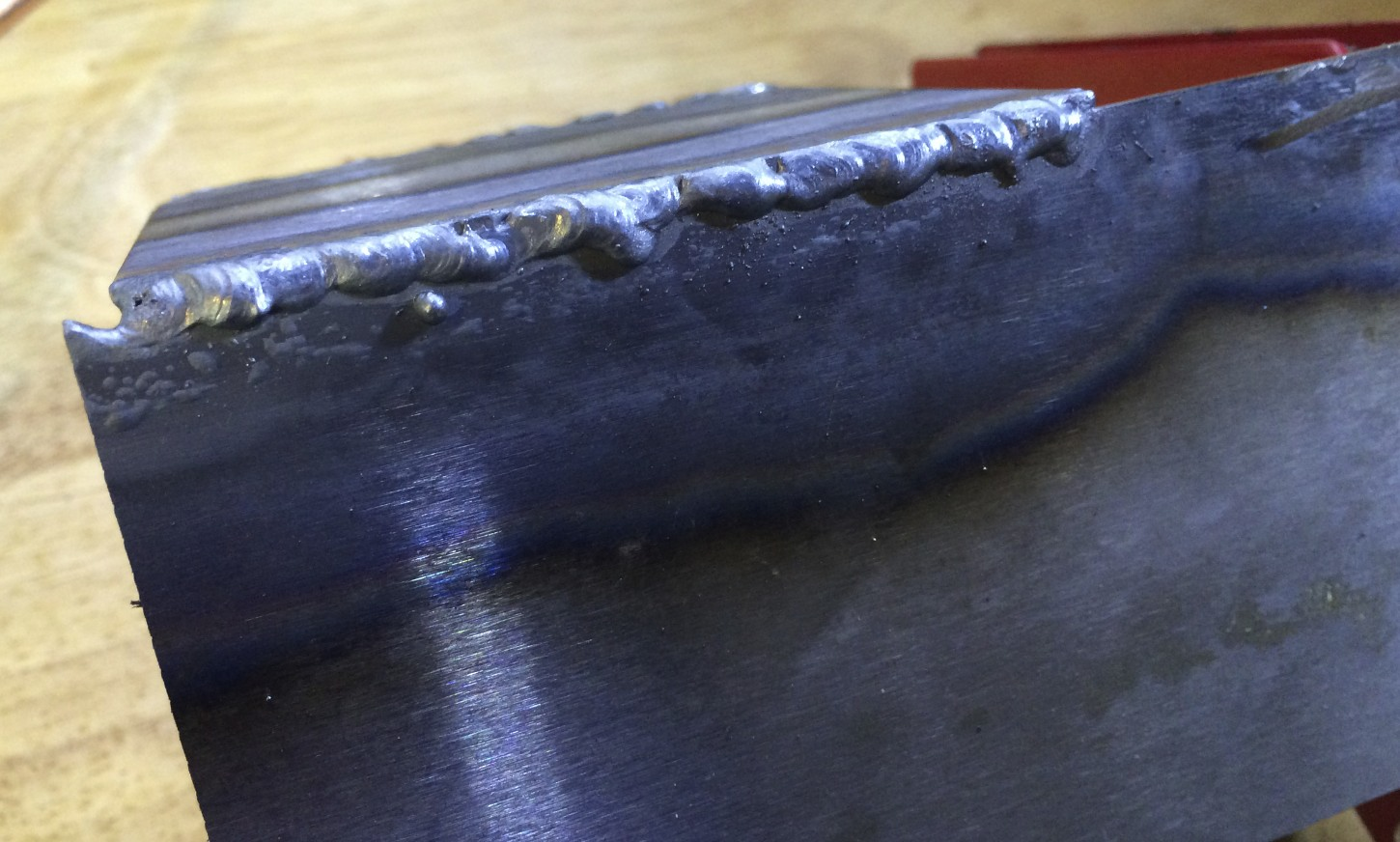 Second weld. Still pretty ugly, but much stronger than the first weld; I had to cut the two plates apart.