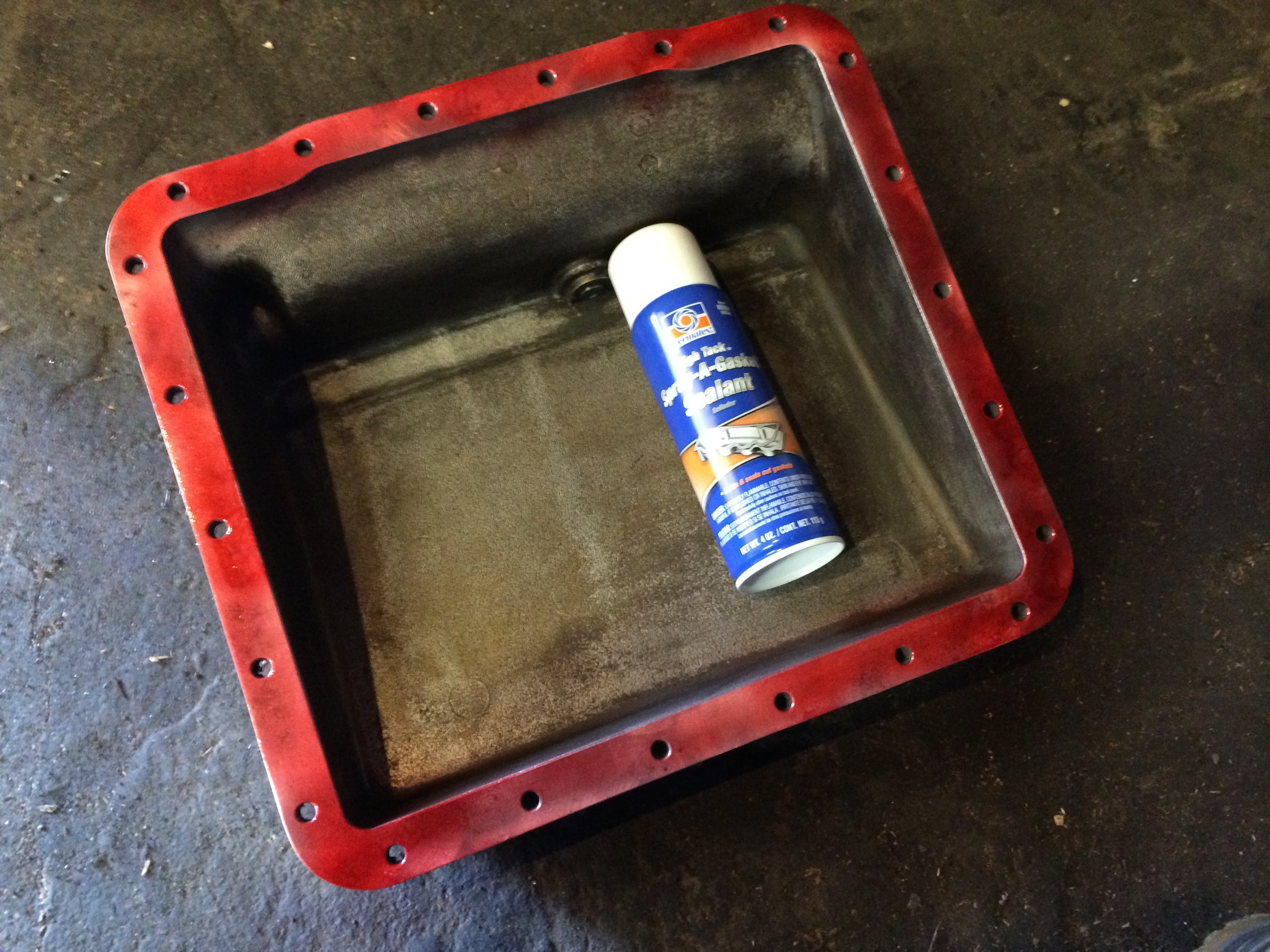 High-tack sealant applied to the mating surface on the oil pan.