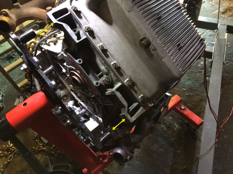 The large gap (marked by the yellow arrows) between the stand's fingers and the engine resulted in a large amount of downward force that made it extremely difficult to rotate the engine.