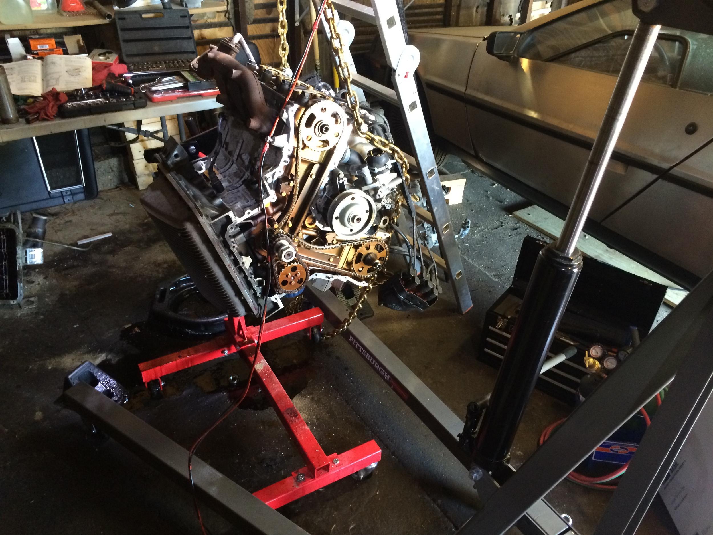 Using the engine hoist to rotate the engine.