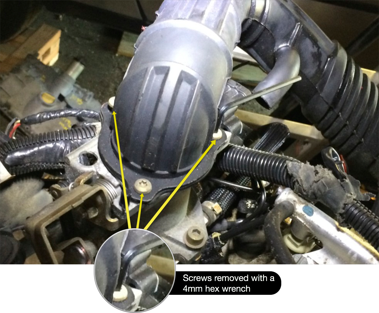 The air intake hose to the throttles is secured with three hex screws requiring a 4mm hex wrench.