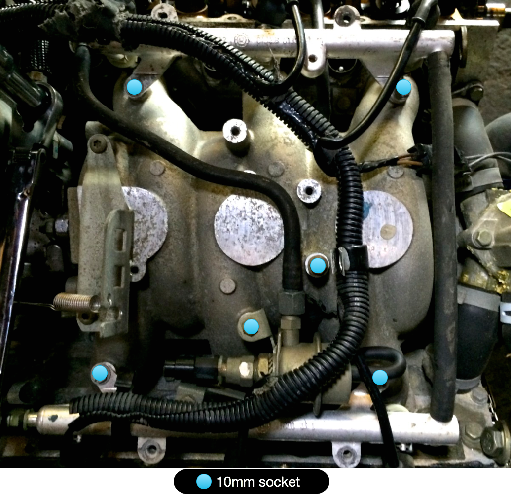 A 10mm socket removes the six bolts holding the fuel rails to the intake manifold.