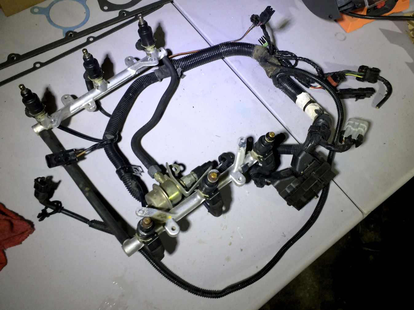 Removed fuel rails, injectors and harness.