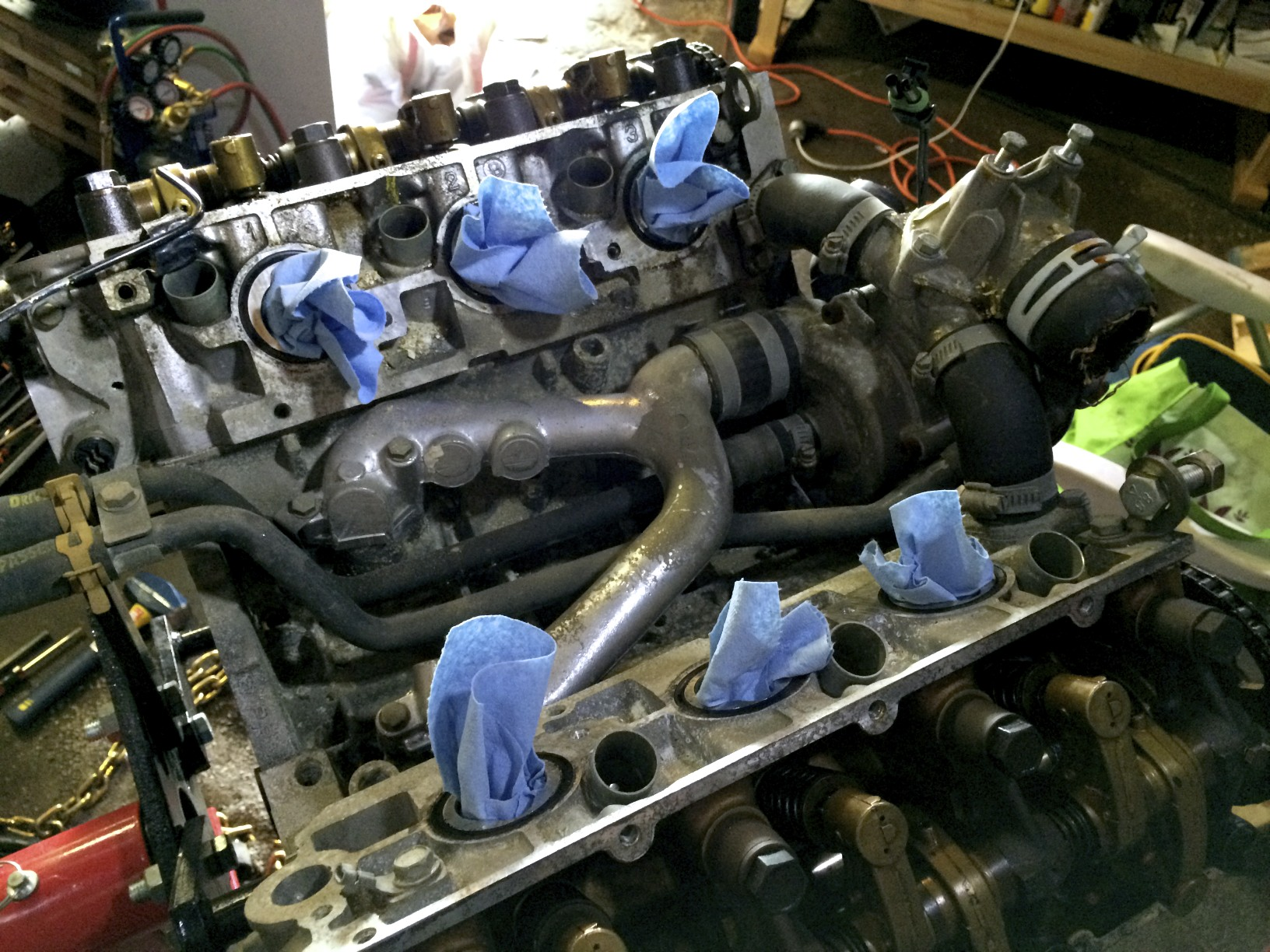 Inside the valley, under the manifold.