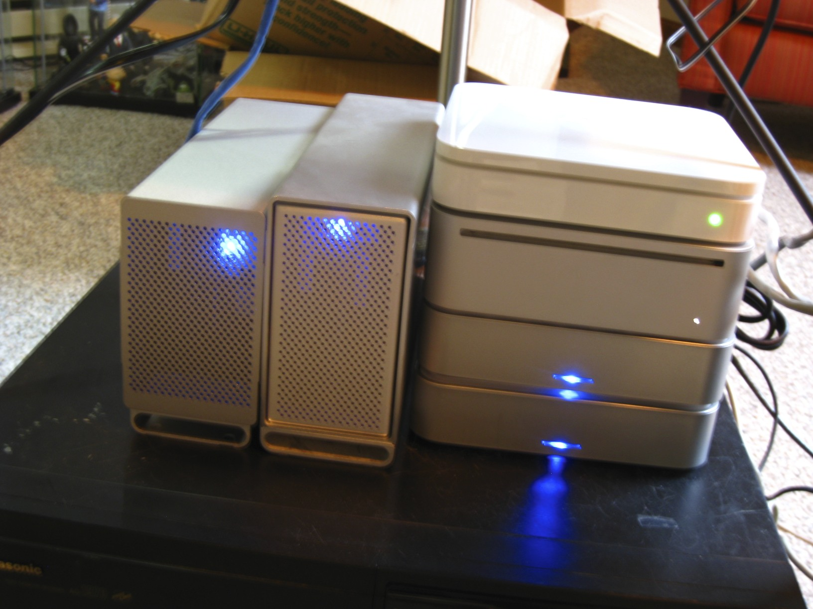 Mac mini, Airport Extreme and four hard drive enclosures configured as mirrored RAIDs