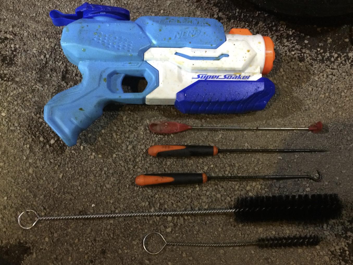 "Super Soaker Freeze Blaster, ""last drop"" spatula, picks, and bristle brushes.,"