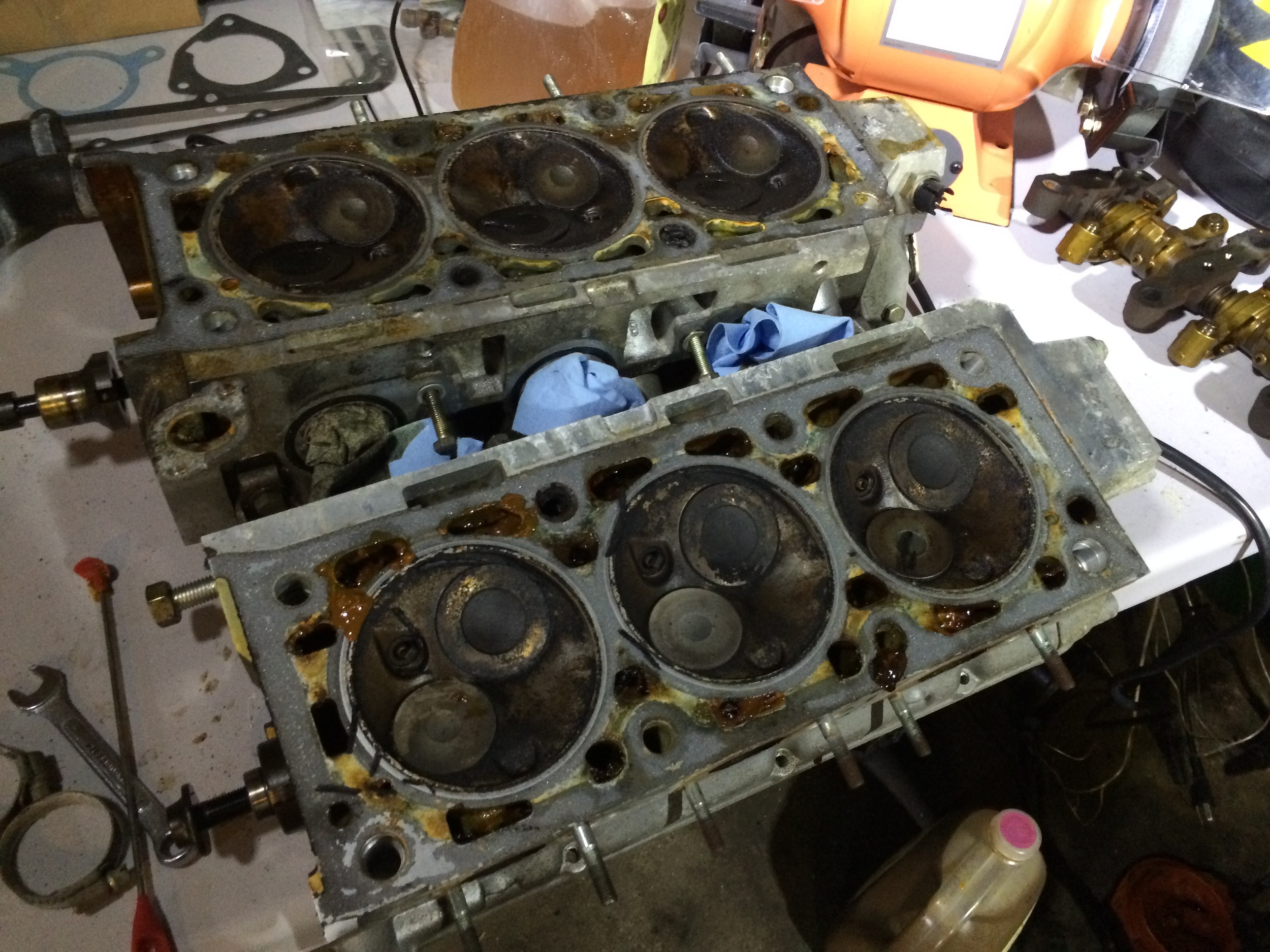 Dirty cylinder heads. Notice the oil plugging the passages in both heads.