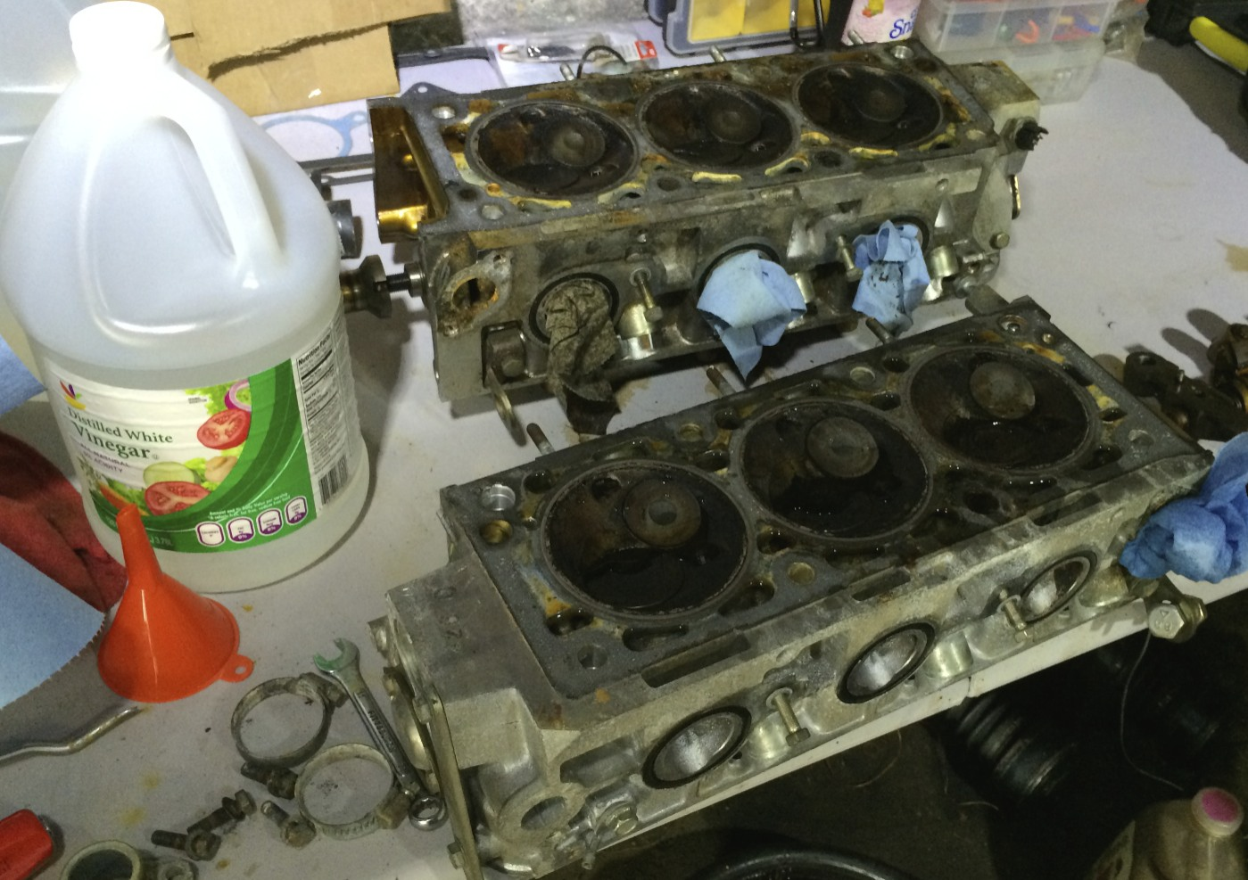 The near head's coolant passages filled with vinegar in order to further clean out the passages. While I waited, I removed the head gasket remnants with a combination of tools.