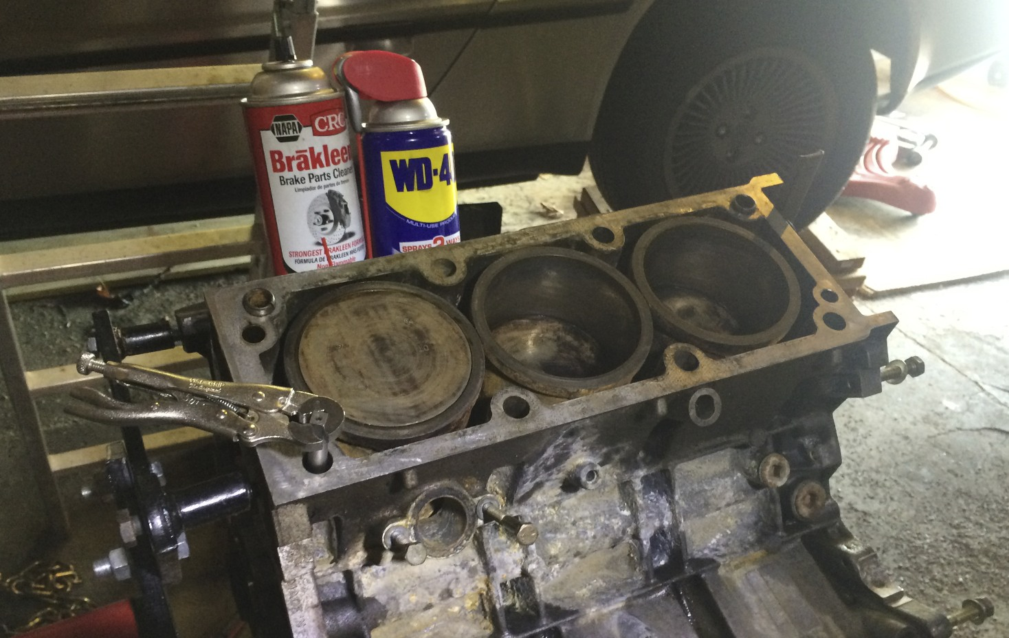 The tap is used with WD-40 and cleaned with brake cleaner. I forgot my T handle, so I used vice grips to run the tap.