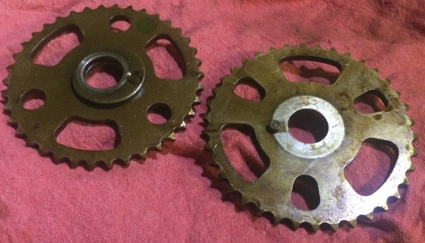 The driver's and passenger side sprockets are slightly different, with the driver's side one (left) having a built-in spacer.