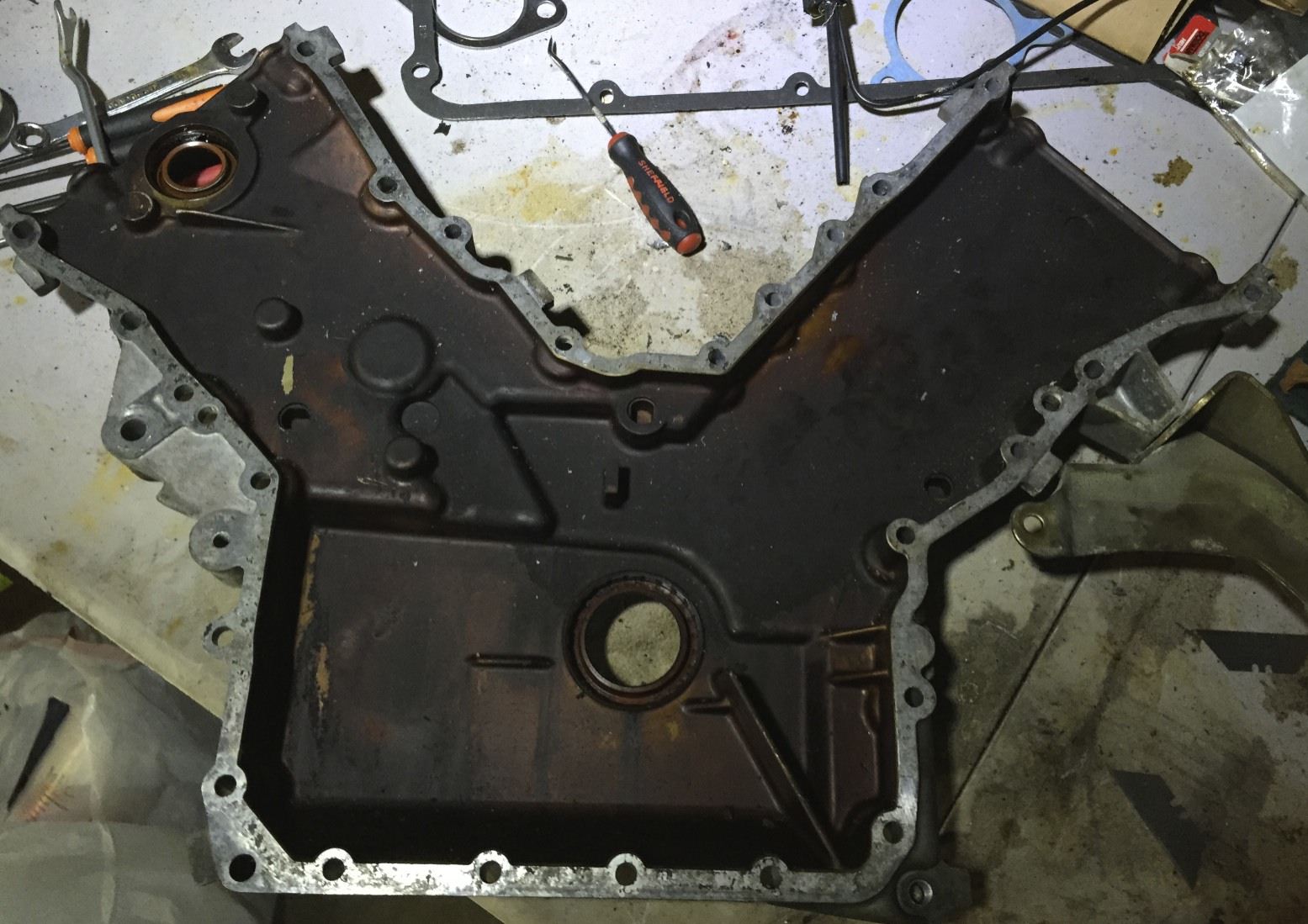 The timing cover after the gasket has been removed.