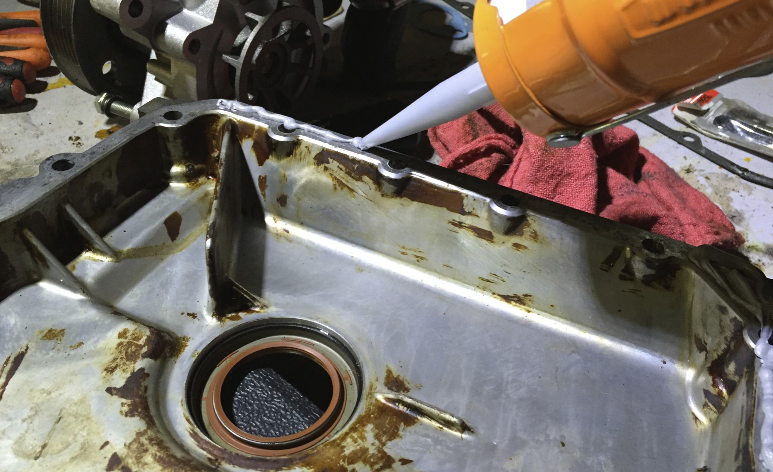 Applying Right Stuff to the timing cover's mating surface