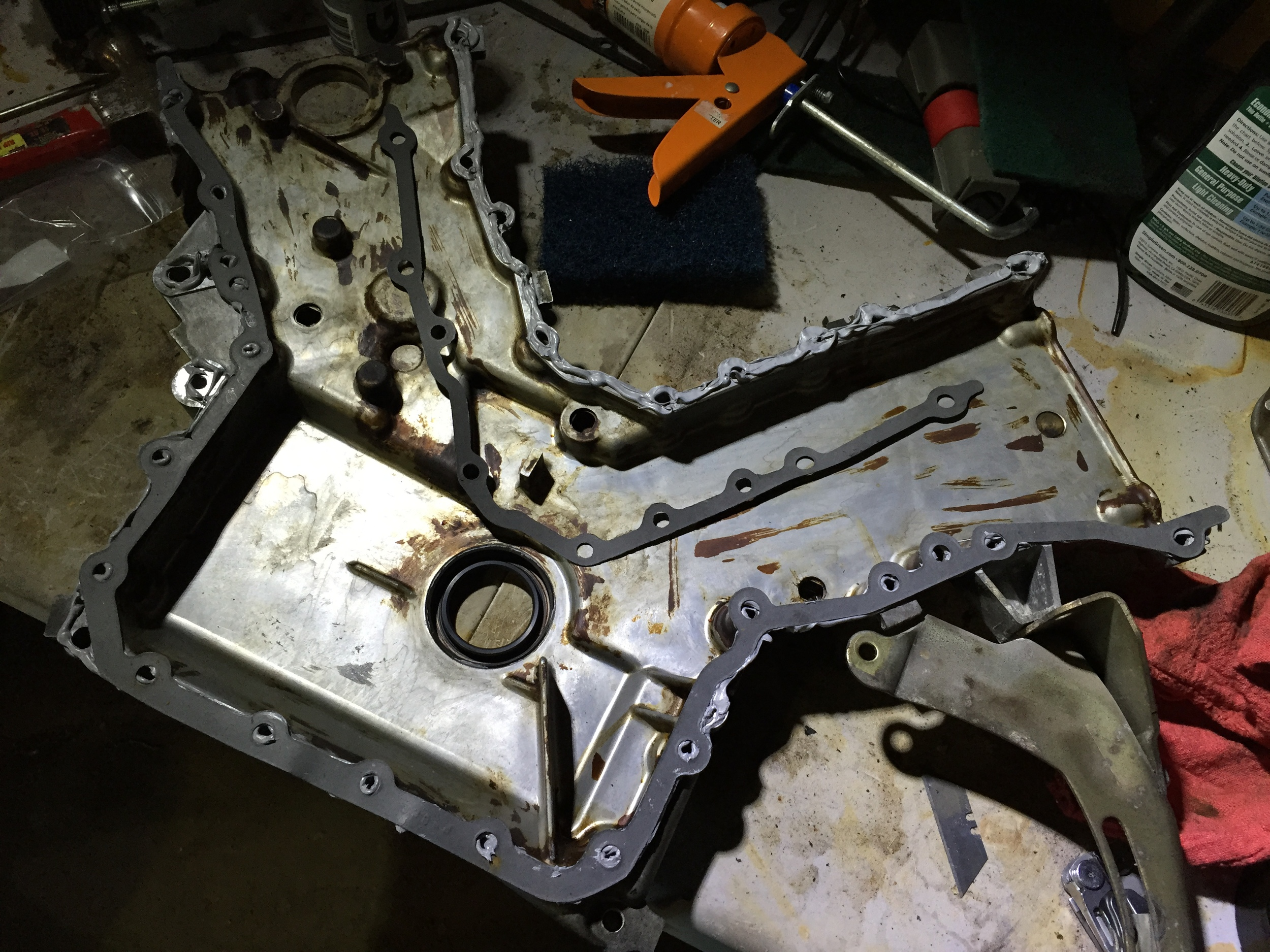 Liberal amounts of Right Stuff applied to install the upper timing cover gasket. The lower gasket is already mounted on the cover.