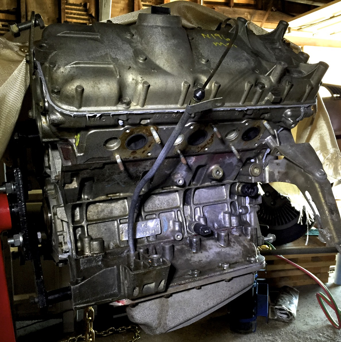 The engine dipstick reinstalled in the lower crankcase.