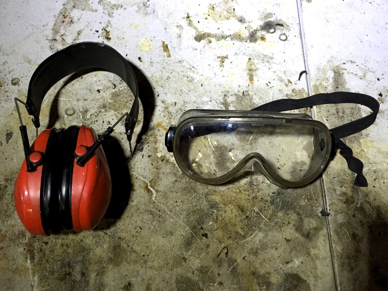 Muff-style hearing protectors and safety goggles.