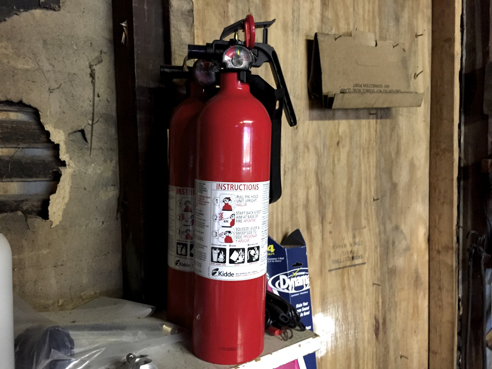 Two fire extinguishers. The one in the back is slightly discharged, so I got a second one to be sure I'm safe.
