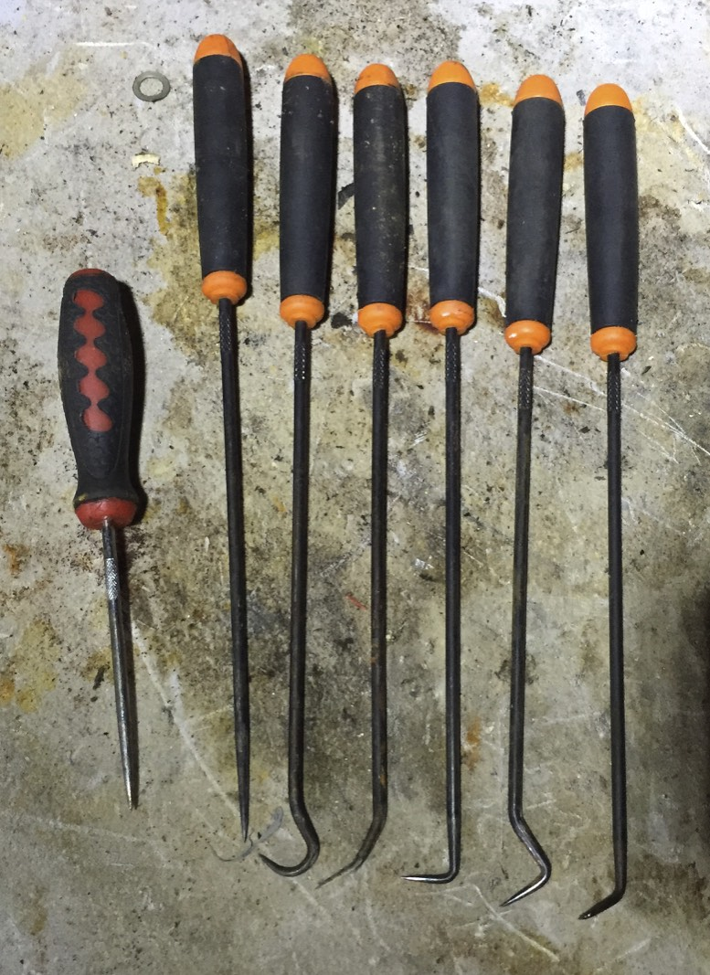 A short pick (left) and a series of long handle picks.