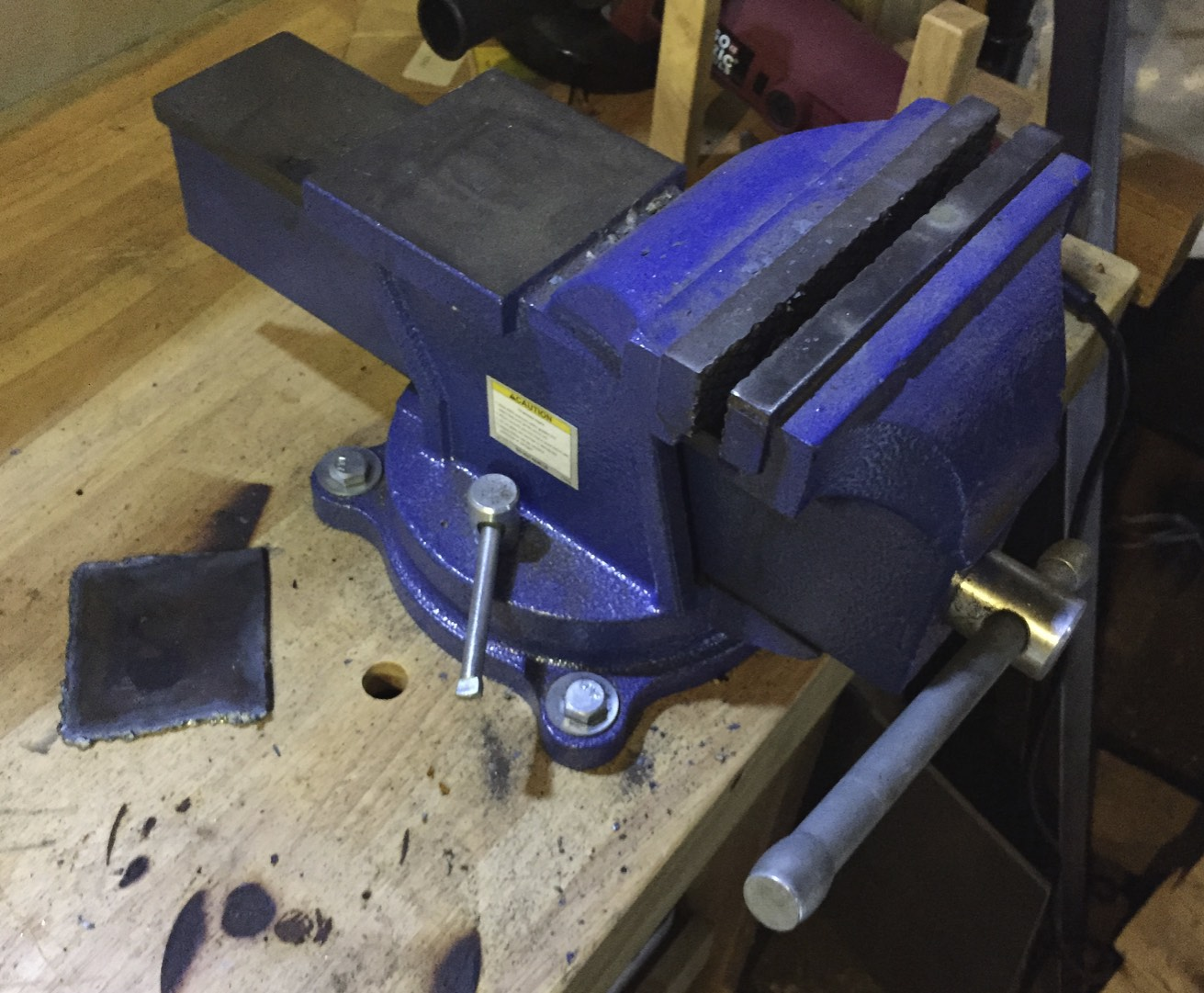 A bolted-down bench vice.