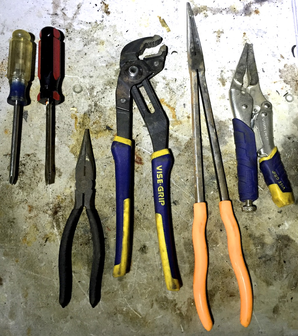 From left to right, Philips and flathead screwdrivers, pliers, adjustable pliers, long-handled needle nose pliers, locking pliers (aka vice grips).